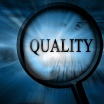 Magnifying glass, and the word Quality