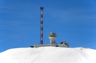 Mountaintop lookout station with radio mast